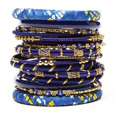 The bangles are covered in silk and adorned with gold thread and intricate designs.