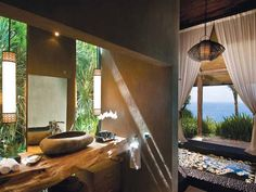 Wow! I love a bath with a view! So many designers forget to make the bath as special as the rest of the home!