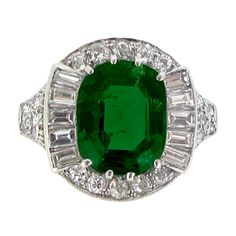 Emerald and diamond cluster ring, circa 1925. | From a unique collection of vintage engagement rings at http://www.1stdibs.com/jewelry/rings/engagement-rings/