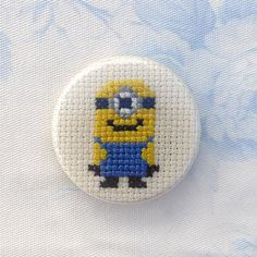 Despicable Me cross stitch 35mm pinback by PetipoaNeedleCraft www.petipoaneedlecraft.com