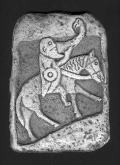 """Pict with Drinking Horn    This 9th century warrior of the Pictish tribe drinks from an eagle, the ancient symbol of power. From Invergowrie, Scotland and now in the Museum of Scotland, it is an unusually droll carving, certainly a caricature, perhaps in the category of the Scandinavian insult stones, which were carved as an artistic and bloodless """"thumbing of the nose"""" to a perceived insult. It is the earliest artistic rendering of drinking on Scottish stones."""