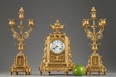 CLOCK AND PAIR OF CANDELABRAS IN LOUIS XVI STYLE Late 19th century