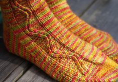 This pattern is my solution to the variegated yarn conundrum - that one where a gorgeous skein of yarn refuses to knit well in a pattern, but the thought of yet another totally stockinette sock is too monotonous to bear.