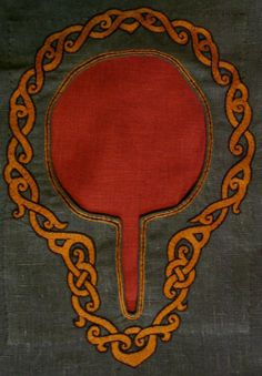 Beautiful embroidery on the neck opening of a tunic.