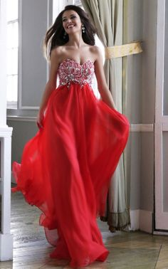 Flowing Sherri Hill in a vivid red hue for prom 2014 #ipaprom #promdress