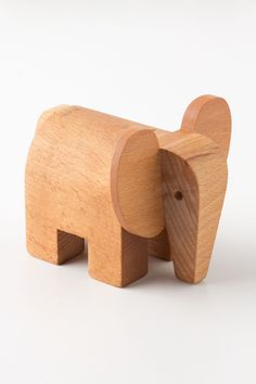 """Dovetail Elephant - the head and tail of this old-fashioned wooden toy fits together like a puzzle."""