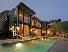 Another view of the Guz house.  Love the infinity pool facing the ocean.  It has bamboo walkways between the buildings - how great is that?  ~ Great pin! For Oahu architectural design visit http://ownerbuiltdesign.com