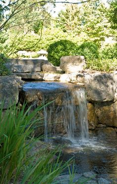 A very natural looking waterfall in an East Sussex garden created by Acres Wild. www.acreswild.co.uk