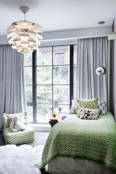 green & silver grey bedroom with artichoke light, black metal frame windows, design by Steffani Aarons
