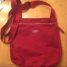 Tumi red nylon crossbody Tumi Nylon Crossbody   Bag is in excellent condition, no scratchs, no snags, no stains  Smoke free home Tumi Bags Crossbody Bags