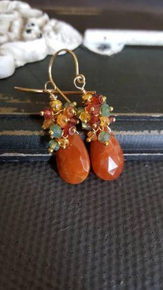 Copper Quartz with Colorful Gemstone Cluster Earrings Gift for Her Fall colors shine brightly in these beautiful earrings. A 16mm faceted copper quartz teardrop is dressed with a cluster of gorgeous 2.5-3mm faceted rondelles that include green labradorite, mozambique garnet,