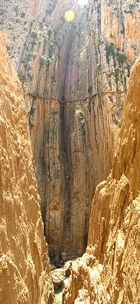 El Caminito del Rey (English: The King's little pathway) is a walkway, now fallen into disrepair, pinned along the steep walls of a narrow gorge in El Chorro, near Álora in the province of Málaga, Spain. The name is often shortened to Camino del Rey (English: King's pathway).