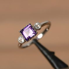 It is a real natural purple amethyst ring. The main stone is 6 mm*6mm square cut amethyst, weight about 1.02 carats. The basic metal is sterling silver and plated with rhodium.  To change the metal to a solid gold (white/rose) or platinum is also available, please ask for a quotation if you want.  You can also go to my shop Home for more elegant rings: https://www.etsy.com/shop/godjewelry?ref=hdr_shop_menu  Amethyst is the birthstone of January. More amethyst rings…
