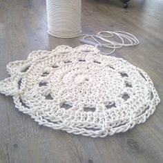 Giant Doily Rug - this is lovely, and in colors...