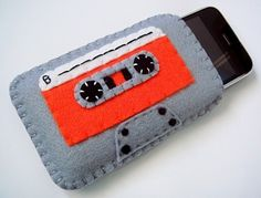 Keep your iPhone cozy in this Grey and Bright Orange Cassette Tape Case! Entirely handmade out of felt with an orange inner lining, this adorable Felt Diy, Felt Crafts, Fabric Crafts, Sewing Crafts, Sewing Projects, Diy Crafts, Felt Phone Cases, Felt Case, Pochette Portable