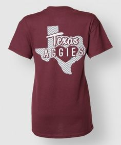 "This maroon shirt is perfect for looking cute and showing your Aggie pride. It features a block ATM on the front in grey and white chevron with a large Texas on the back. The Texas is gray and white chevron print, and has ""Texas Aggies"" across it. There is also a star to feature where the forever home of all Aggies is...College Station!"