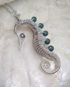 Seahorse necklace  //  love this, going to make this