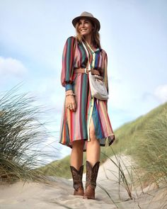 Multicolored dress belt, crossbody bag, cowboy boots and fedora | Photo shared by Claudia Kooij | For more style inspiration visit 40plusstyle.com