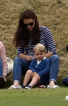 The Duchess of Cambridge and Prince George watching Prince William play polo.