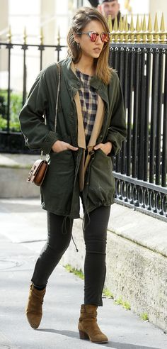 This Is the Perfect Outfit for Everything You Do on Saturdays via @WhoWhatWear | plaid shirt, tan cardi, army green jacket, charcoal skinny jeans, tan ankle boots, mirrored sunglasses and mini-crossbody