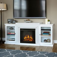 The Frederick boasts glass doors and supports up to a 100-pound TV with adjustable shelving for components. Electric unit plugs into any standard outlet and features a remote control.