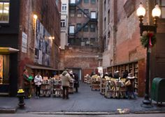 Take a trip to the Brattle Book Shop. The Brattle Book Shop is one of the oldest and largest used book shops. Not only do they have 3 stories worth of books, they have an outdoor sale lot, shown in the photo. Atlantis, The Places Youll Go, Places To Go, Boston Things To Do, Alleyway, In Boston, Boston Town, Boston Weekend, Downtown Boston