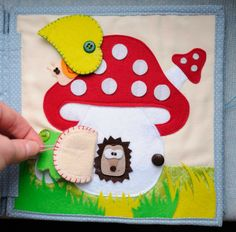 very cute quiet book page with a mushroom house and little flaps.
