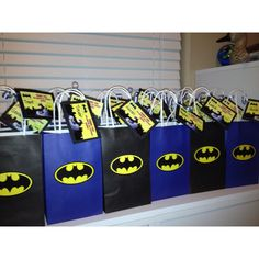 Ideas for Batman party - blue and black gift bags with batman logo sticker