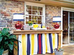 Decorating My Deck | table with striped curtain hiding shelves