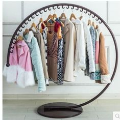 Europeanstyle iron art clothes hat stand on the floor of a fashion clothing store display rack is part of Clothing store displays, Clothing store interior, Clothing store design, Furniture store inter -