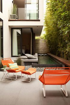 Small courtyard, peaceful space with bamboo, water, large corner windows and small patio seating areas