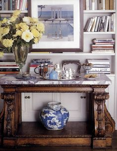 .marble slab in top of old wood table: bar setting in library
