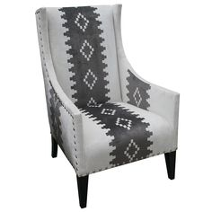 Andrew Martin Pluto Chair. The basic black and white allows this patterned piece to transition into any room in your house seamlessly.