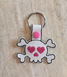 A personal favorite from my Etsy shop https://www.etsy.com/listing/496612276/skull-key-chain-zipper-pull-marine-vinyl