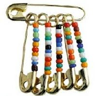 """Friendship Pins - These cool safety pins were great! The kids would load them up (small and golden were by far the safety pin of choice) with tiny colored beads and attach them to purses and backpacks. They were coined """"Friendship Pins"""" because they were often given to or traded with friends."""