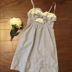 AE Dress Gently used condition. Needs a good ironing but that's about it! Perfect for upcoming graduations, summer bbqs, and weddings! Has a neat tie in the back and adjustable straps. American Eagle Outfitters Dresses Mini