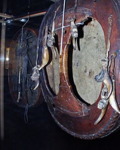 """Back of Sami shaman drum (""""runeboome"""" in Norwegian) that housed in Copenhagen. Showing talismans nailed to the back."""
