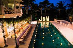 poolside weddings - photo by Imaj Gallery https://ruffledblog.com/vibrant-bali-wedding-with-a-hanging-botanical-installation
