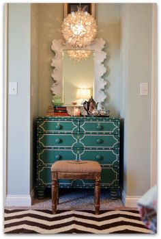 a lovely room design by Darlene of Fieldstone Hill Design.  Have always loved that mirror.  It pairs well with this green dresser.