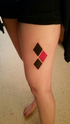 Umbrielle's Harley Quinn tattoo, done by Joey Smith at Tattered Soul.