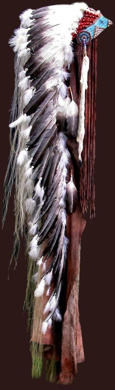 Plains Indian Headress ~  CHIEF'S CROWN -       Many deeds have I done and for each I have earned a feather from the eagle, Great Spirit. I have hunted and counted coup on many enemies and have proved myself to be worthy of this crown. My teepee, my home and the circle of life are represented here along with the blessings of the elk and deer. The ermine of richness hangs from each side and I have done well. I am Chief and I am proud.