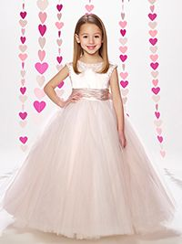 b6b3285f4cd This satin   tulle floor-length full A-line dress features a pearl wrapped  tulle slight cap sleeves with a jewel neckline and a wide ruched satin  waistband.