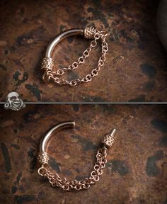 How cool would it be to have this in! 14K rose gold double chain septum spinner