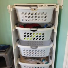 Finished laundry sorter! Took two coats of high gloss paint to cover.  Laundry room redo!