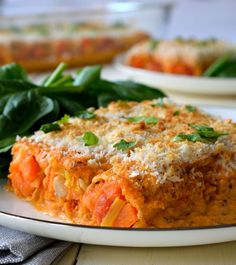This vegan cannelloni recipe is a delicious soy-free dish of roasted root vegetables stuffed inside pasta tubes and smothered in a homemade romesco sauce.