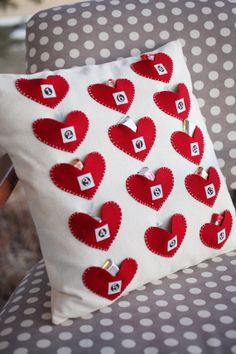 "too cute $13.75 Kit includes pattern, fabric and iron-on labels to complete one 16"" square pillow. Does not include the pillow form. Each heart is a pocket that can be filled with treats to countdown to Valentine's Day."
