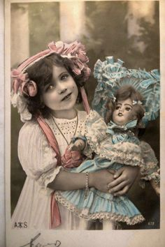 Antique French postcard - Girl with a doll