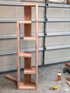 Easy gorgeous DIY modern bookshelf idea with plans! Easy gorgeous DIY modern bookshelf idea with plans! Diy Bookshelf Design, Diy Bookshelf Plans, Modern Bookshelf, Bookshelves, Diy Bookshelf Wall, Tree Bookshelf, Modern Shelving, Diy Furniture Projects, Diy Furniture Plans