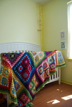 These colorful granny squares are put together into an amazing crochet blanket.