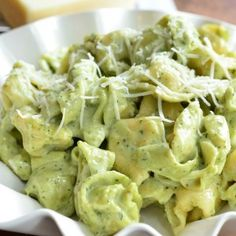 The best simple dinner that you can whip up in about 30 minutes. Comfort food at it's tastiest, tortellini made with homemade pesto and Alfredo sauce.